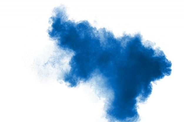 Blue color powder explosion cloud on white background.