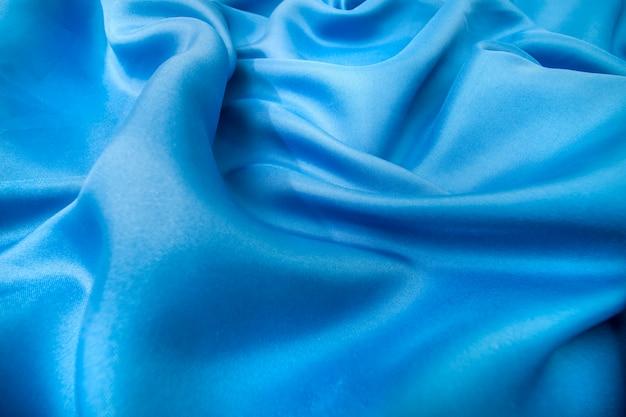 青い色のシルク生地の背景