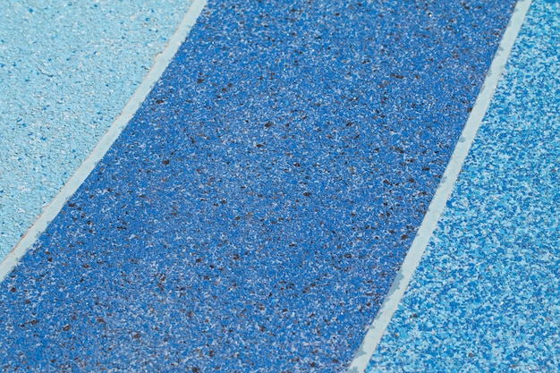 Blue color tone of terrazzo floor out door lane for exercise or out door sport area.