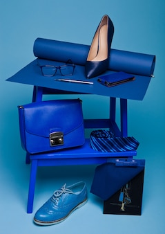 Blue composition with shoe, tie, glasses, bag, pen and notebook