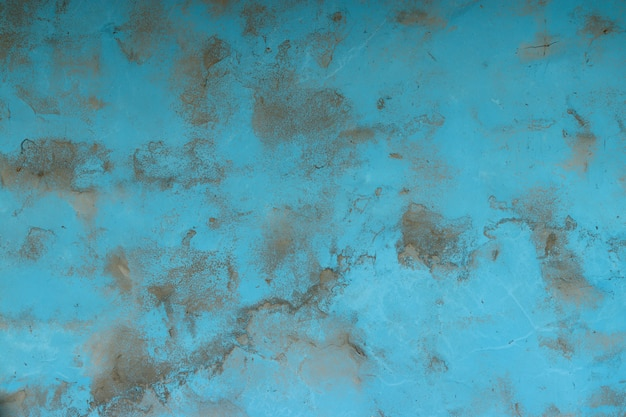 Blue concrete background with gray spots texture surface copy space for design or text