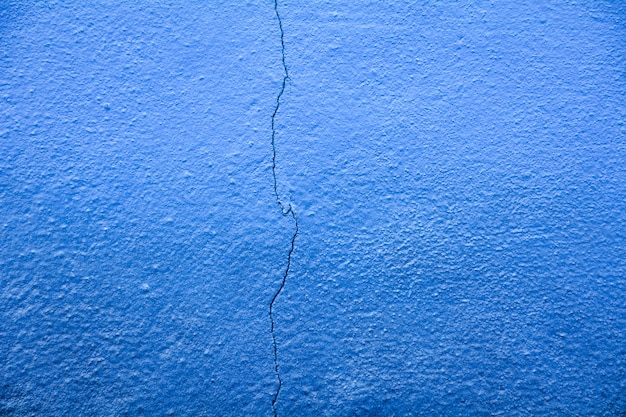 Blue concrete crack wall texture at building