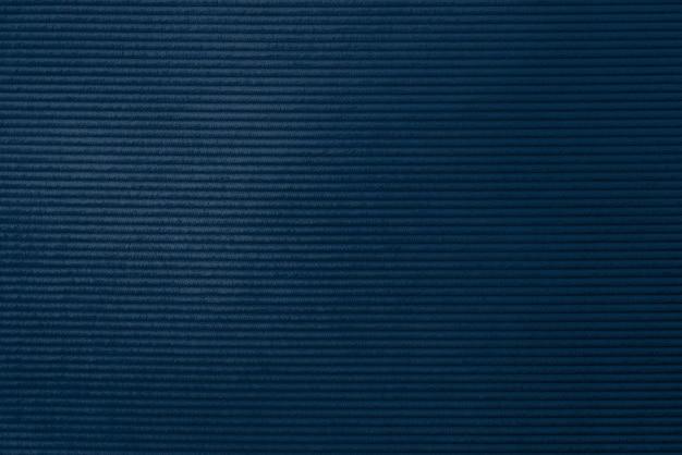 Fondo strutturato del tessuto di velluto a coste blu