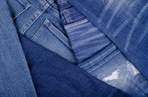 Blue cotton jeans texture background with copy space.