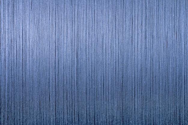 織り機からの青い綿糸、藍染めの糸織りの背景、