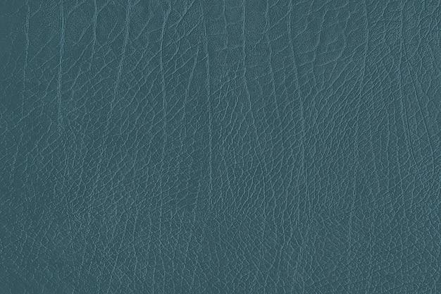 青いしわのある革の織り目加工の背景