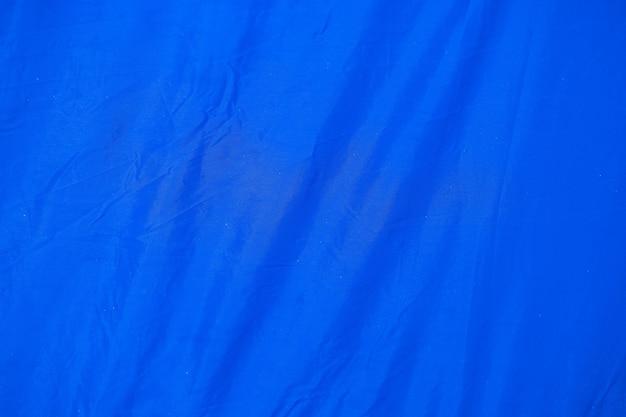 텐트 패브릭 페이지 종이 질감 거친 배경으로 구겨진 파란색. 주름 그런 지 양피지 패턴 포도주 디자인