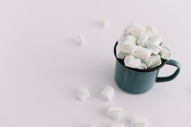 Blue cup full of soft marshmallows