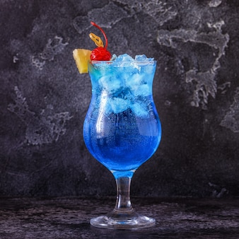 Blue curacao cocktail decorated with fruit