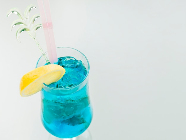 Blue curacao cocktail with lemon and ice