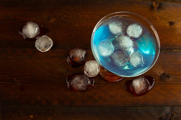 Blue curacao liqueur with ice, top view