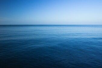 Blue dark and deep ocean, Horizontal seascape with blue sky