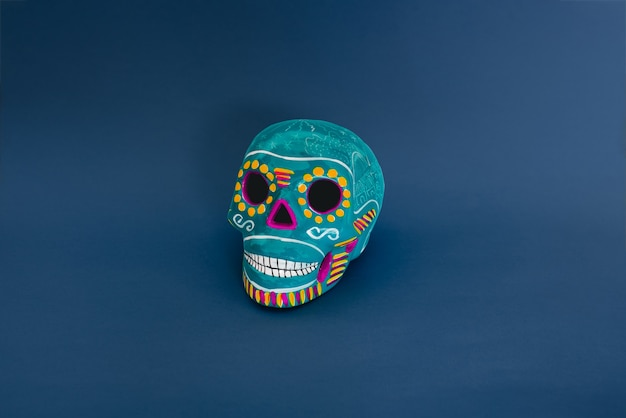 Blue decorative skull on a blue background