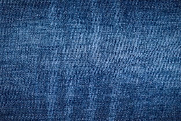 Синий джинсовый фон джинсов. джинсовая текстура, ткань.