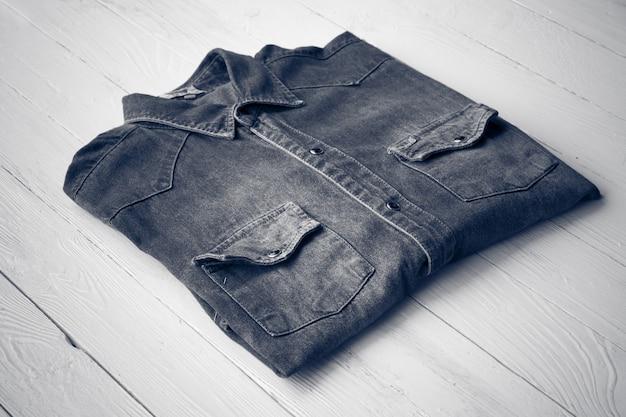 Blue denim jeans on brown wooden