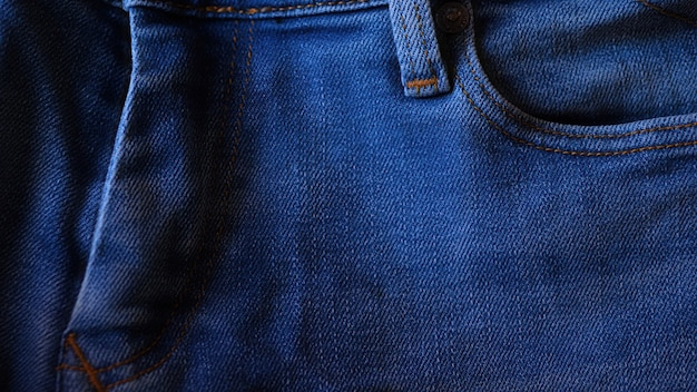 Blue denim jeans close up. detail of the fabric.
