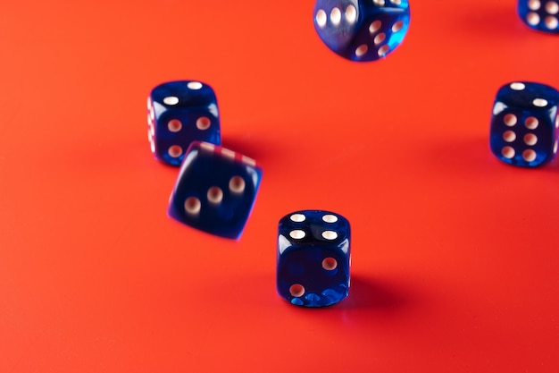 Blue dice on red background