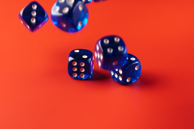 Blue dice on red surface