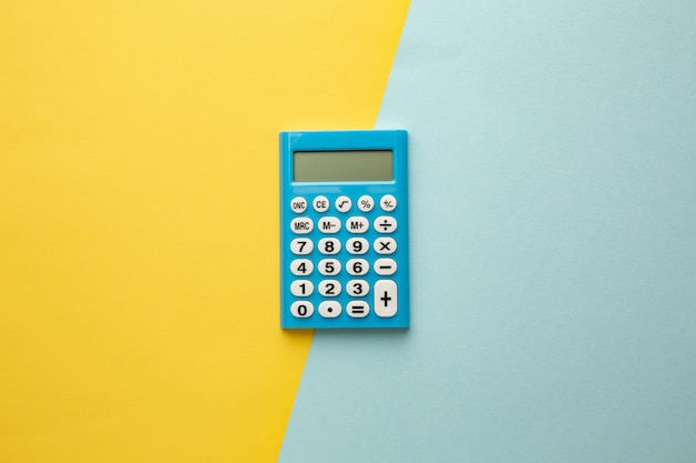 Blue digital calculator on a yellow-blue background. space for your inscription.