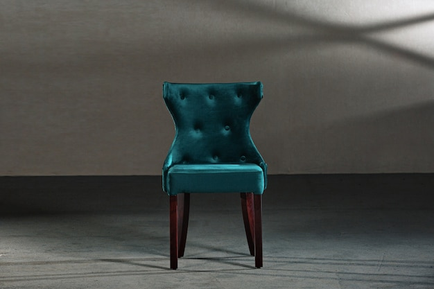 Blue dining room chair in a room with gray walls
