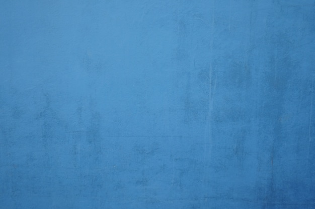 Blue dirty cement wall background.