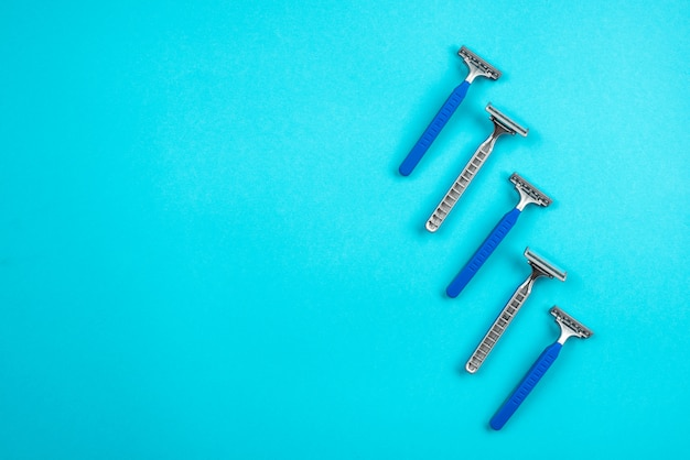 Blue disposable razors isolated on blue background