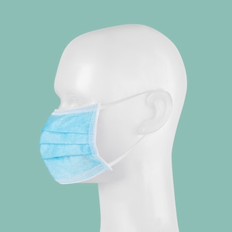 Blue disposable surgical face mask on a mannequin