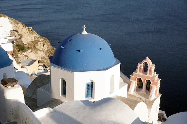 Blue dome church in oia, santorini, greece