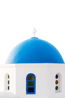 Blue dome of an orthodox church at sunrise in santorini