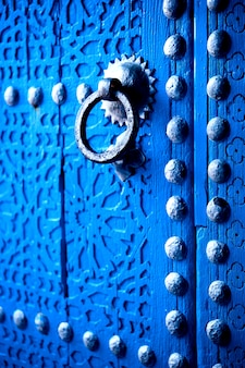 Blue door of the city of chefchaouen in morocco