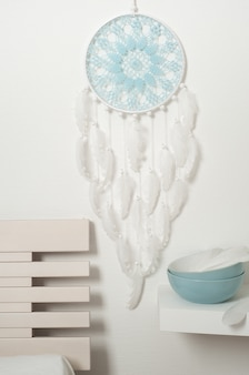 Blue dream catcher with white feathers