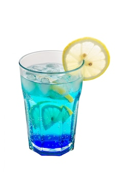 Blue drink with liqueur and ice, decorated with a slice of lemon.