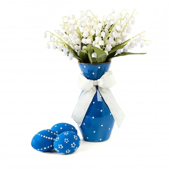 Blue easter decorations on white