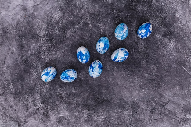 Blue easter eggs scattered on grey table