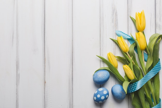 Blue eggs near tulips