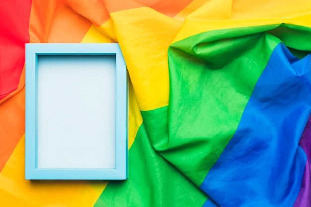 Blue empty frame on crumpled lgbt flag