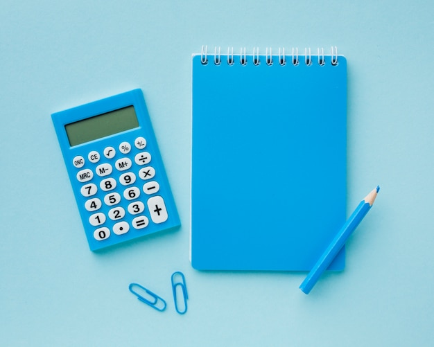 Blue empty notepad and calculator