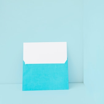 Blue envelope with blank paper inside
