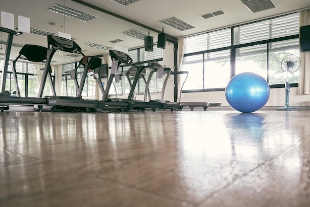 The blue exercise ball placed in the center of the fitness room