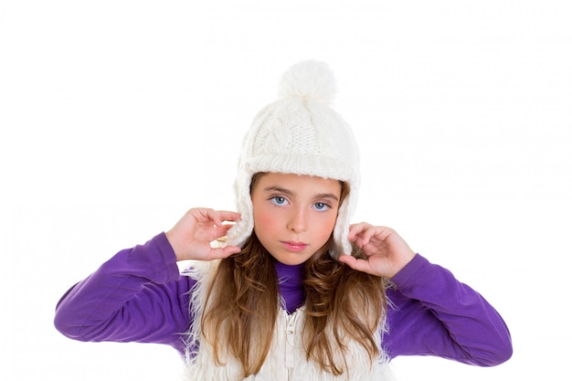 Blue eyes child kid girl with white winter cap fur