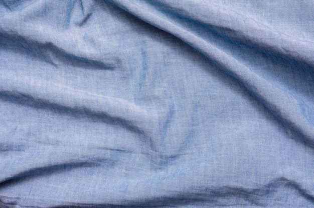 Blue fabric close-up background