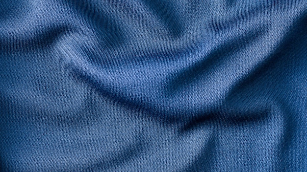 青い布の背景のテクスチャ Premium写真