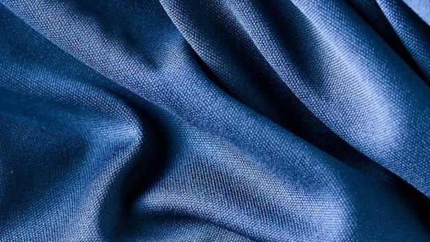 青い布の背景のテクスチャ