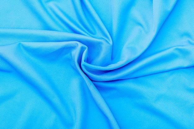 青い布の布、ポリエステルの質感、スポーツウェアの背景