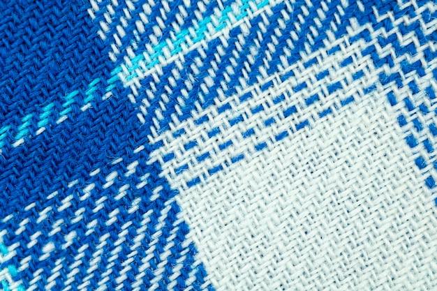 青い生地のテクスチャとパターンの背景、高解像度の綿チェック生地のクローズアップ写真