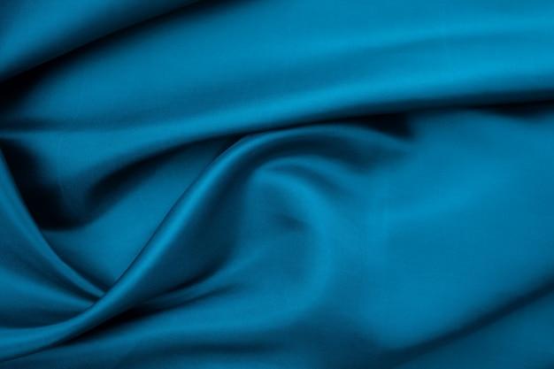 青い布のテクスチャ背景、布の抽象的なクローズアップテクスチャ