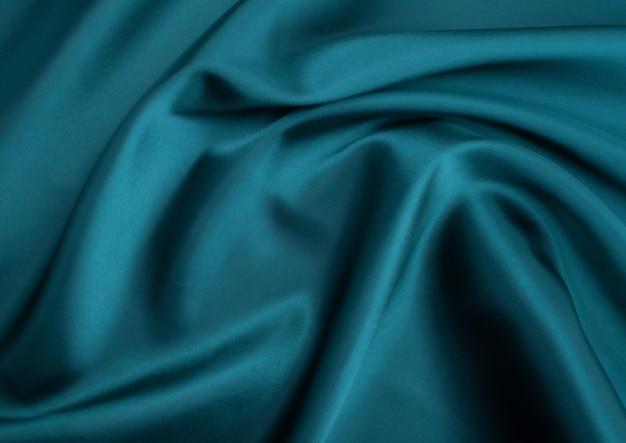 青い布のテクスチャの背景、布の抽象的なテクスチャをクローズアップ
