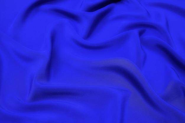 Синий фон текстуры ткани, мягкий синий цвет волнистой ткани, роскошная текстура атласной или шелковой ткани.