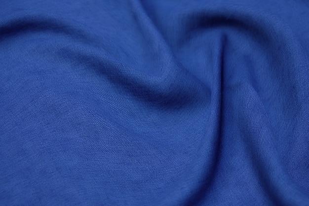 파란색 패브릭 질감 배경, 물결 모양의 패브릭 부드러운 파란색, 고급 새틴 또는 실크 천 질감.