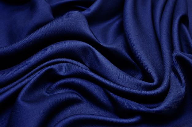 Синяя ткань текстуры фона